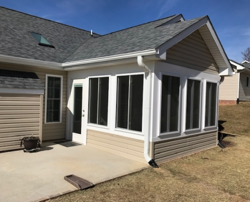 Custom sunroom with vinyl siding