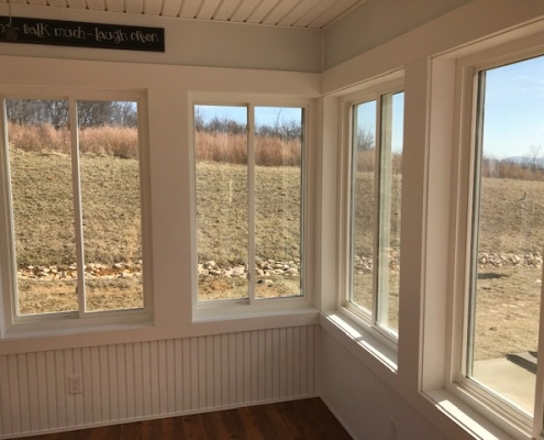 looking out the windows of a sunroom