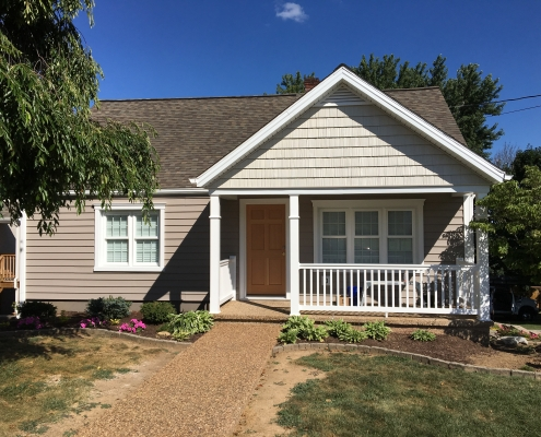 front porch with siding and trim