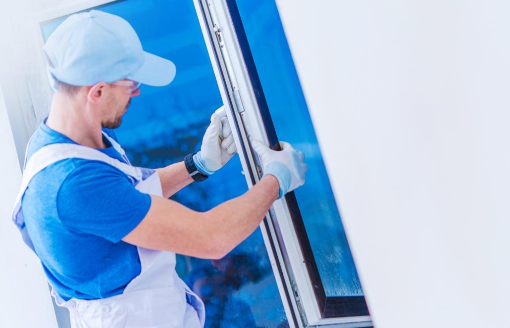 Worker installing a new window